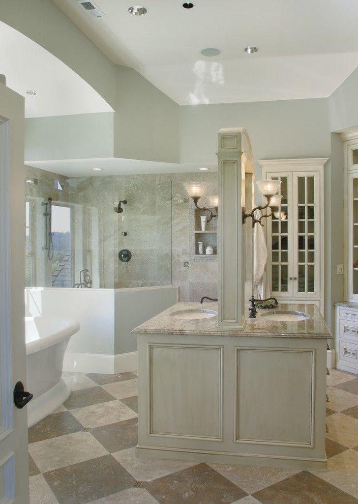 Eloquence Furniture for a Traditional Bathroom with a Limestone Floor Tiles and Montauk Master Bathroom by Tina Barclay