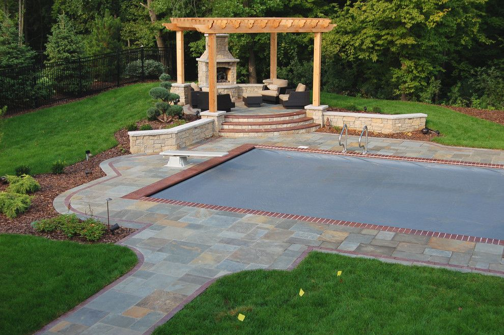 Endicott Brick for a Traditional Pool with a Raised Sitting Area Over Pool and Bluestone Pool Decks, Arbors, Fireplaces, Outdoor Kitchen Under Pavilion by Daryl Melquist @ Bachmans Landscape Design