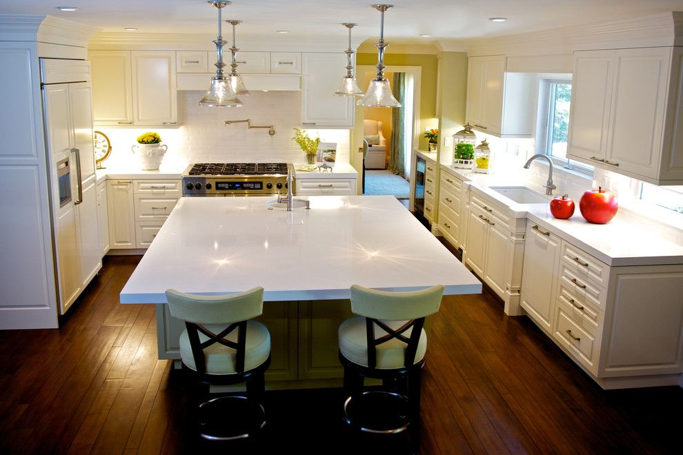 Engineered Hardwood vs Laminate for a Traditional Kitchen with a Built in and Casual and Elegant White Kitchen by Van Zee Design Interiors