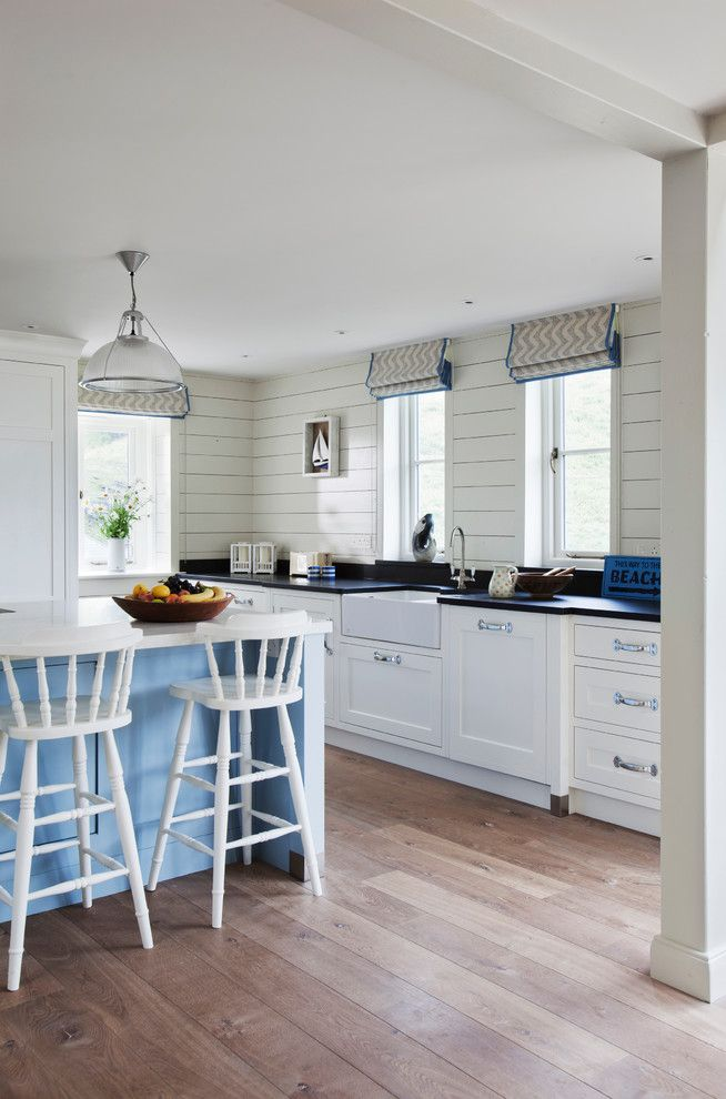 Engineered Hardwood vs Solid Hardwood for a Beach Style Kitchen with a Recessed Lighting and Trebarwith by Stephen Graver Ltd