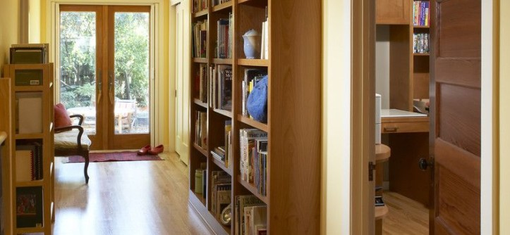 Engineered Hardwood vs Solid Hardwood for a Contemporary Hall with a Custom Shelves and Hall Library by Harrell Remodeling