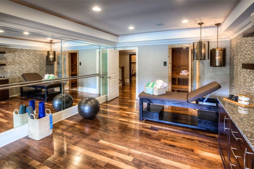 Engineered Hardwood vs Solid Hardwood for a Contemporary Home Gym with a Recessed Lights and Ashton Woods Atlanta Basements by Ashton Woods