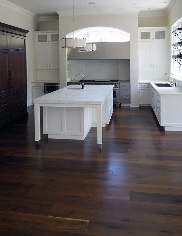 Engineered Hardwood vs Solid Hardwood for a Contemporary Kitchen with a Maple and Black Oak Floors by Signature Innovations Llc