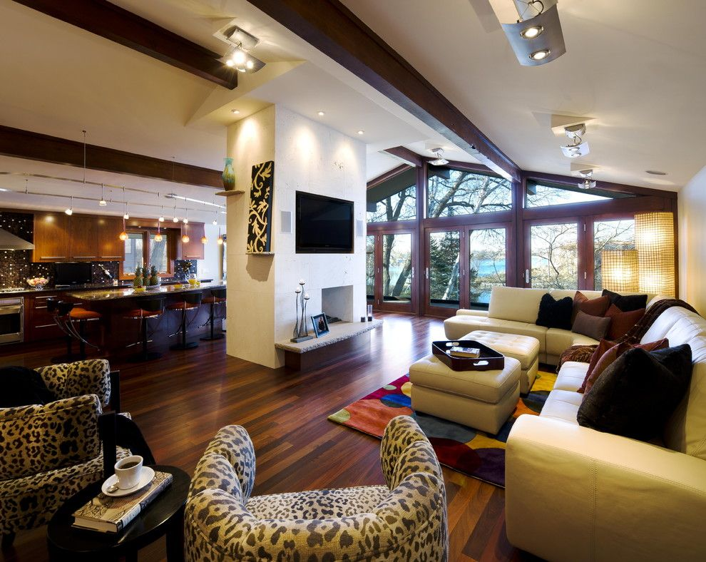 Engineered Hardwood vs Solid Hardwood for a Contemporary Living Room with a Vaulted Ceiling and Jones Design Build by Jones Design Build