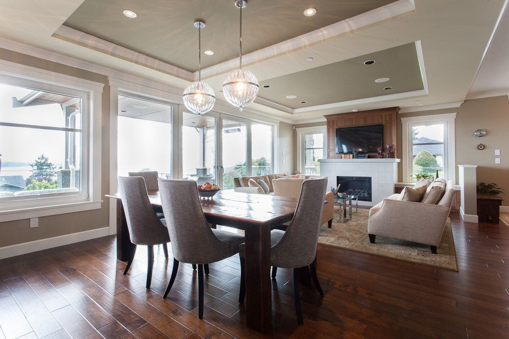 Engineered Hardwood vs Solid Hardwood for a Transitional Dining Room with a Area Rug and Oceanfront Craftsman   Custom Home by Kenorah Design + Build Ltd.
