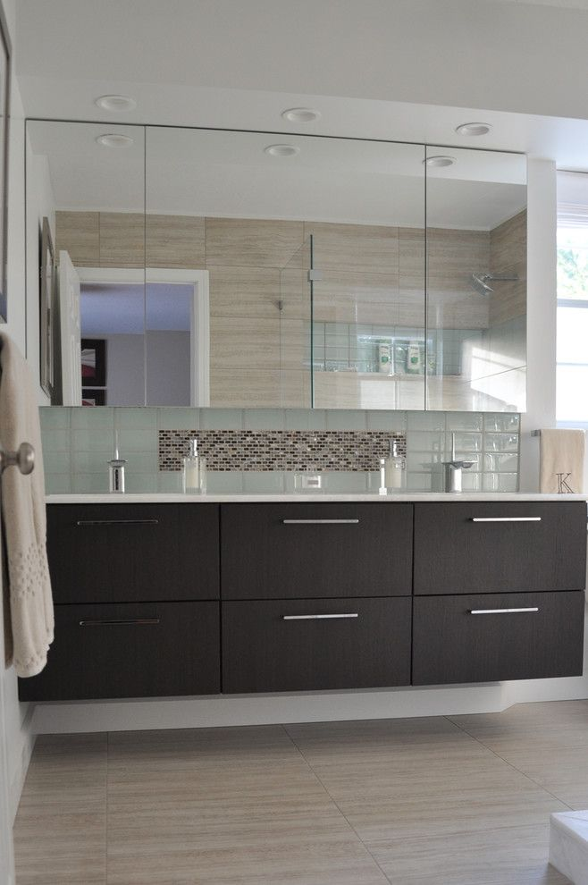 Estridge Homes for a Contemporary Bathroom with a Wall and New England Bathroom by Best Tile