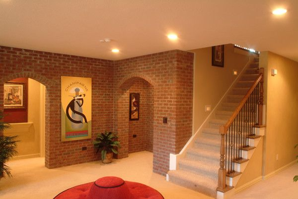 Estridge Homes for a Traditional Basement with a Traditional and Interiors by Estridge Homes