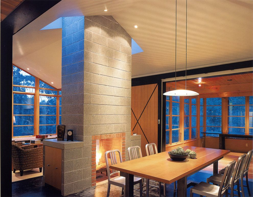 Eureka Lighting for a Rustic Dining Room with a Concrete Fireplace and Buchter Retreat by David Coleman / Architecture