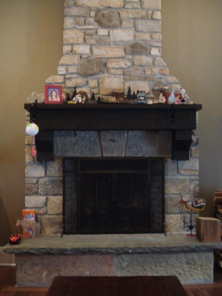 Exscape for a  Family Room with a Barn Stone Hearth and Fire Pits/places by Exscape Designs