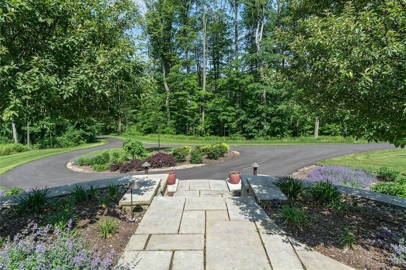 Exscape for a Traditional Landscape with a Driveway and Novelty Contemporary Entrance by Exscape Designs