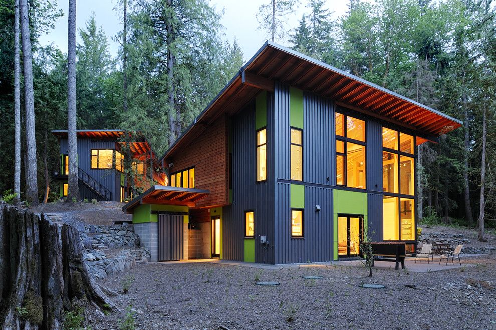 Extech Building Materials for a Contemporary Exterior with a Stone Wall and House in the Woods by Johnston Architects