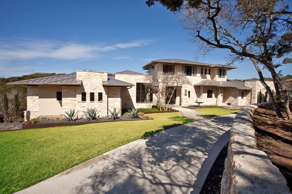 Exterior Color Schemes for a Contemporary Exterior with a Turf and Barton Creek Residence Front Exterior by Cornerstone Architects