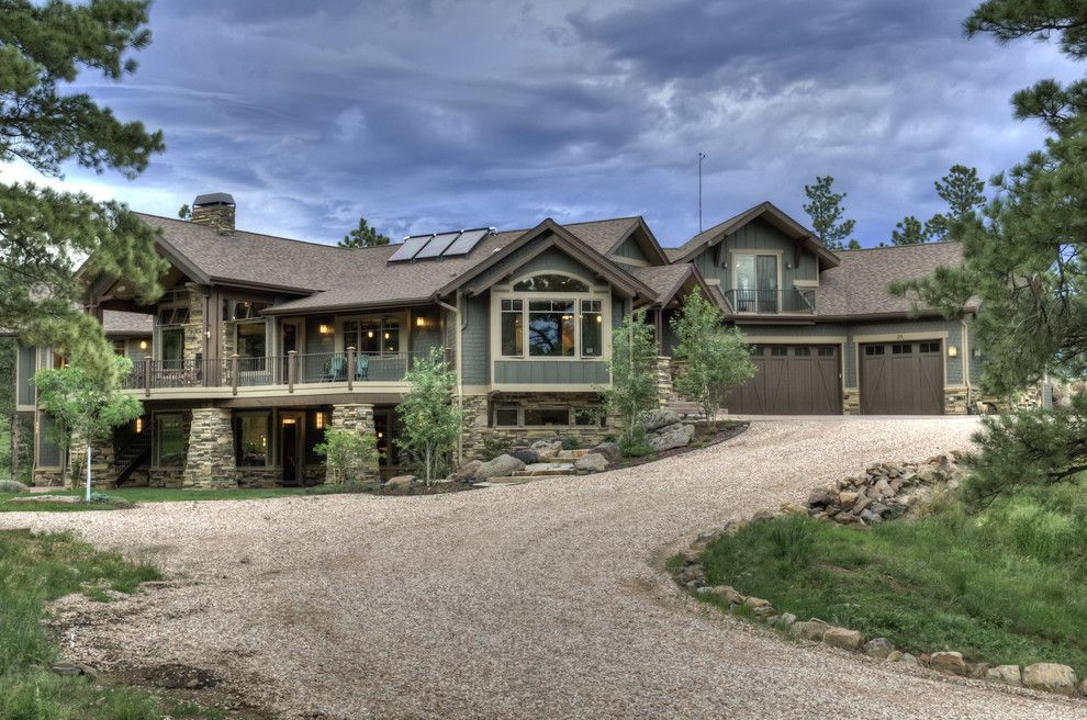 Exterior Color Schemes for a Craftsman Exterior with a Entrance and Exterior by Aneka Interiors Inc.