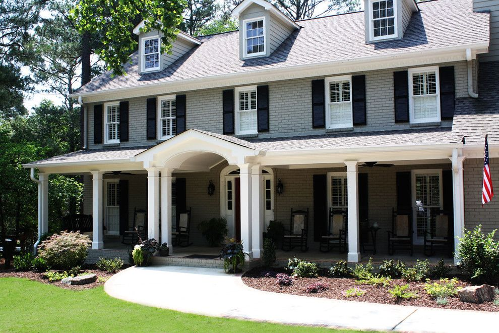 Exterior Color Schemes for a Traditional Exterior with a Lawn and Green Basements & Remodeling   Exterior by Green Basements & Remodeling
