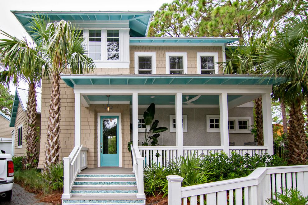 Exterior Color Schemes for a Tropical Exterior with a Blue Mosaic Tile Steps and Hgtv Smart Home 2013 by Glenn Layton Homes