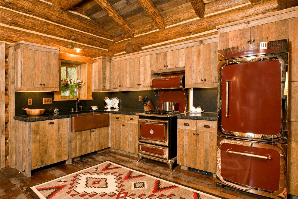 Factory Direct Appliance for a Rustic Kitchen with a Red and Chrome Appliances and Kitchens by Teton Heritage Builders