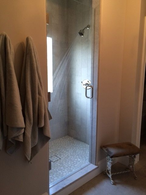 Fallingwater for a Transitional Bathroom with a Limestone and Mosaic Floor Textured Limestone Shower Walls and Ballantyne Country Club Master Bath Remodel by Fallingwater, Llc