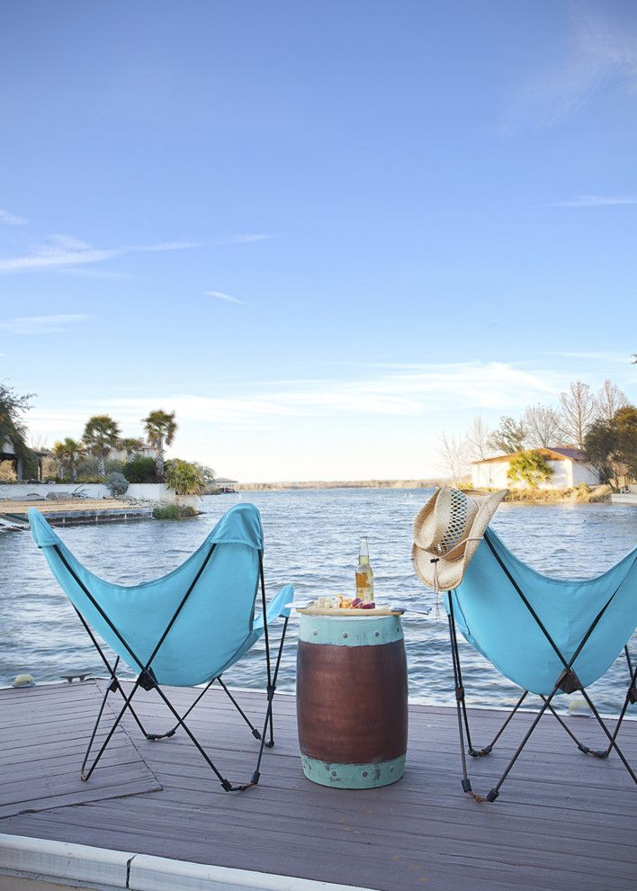 Fallingwater House for a Beach Style Deck with a Lakefront and Hill Country Lake House by Casey St. John Interiors