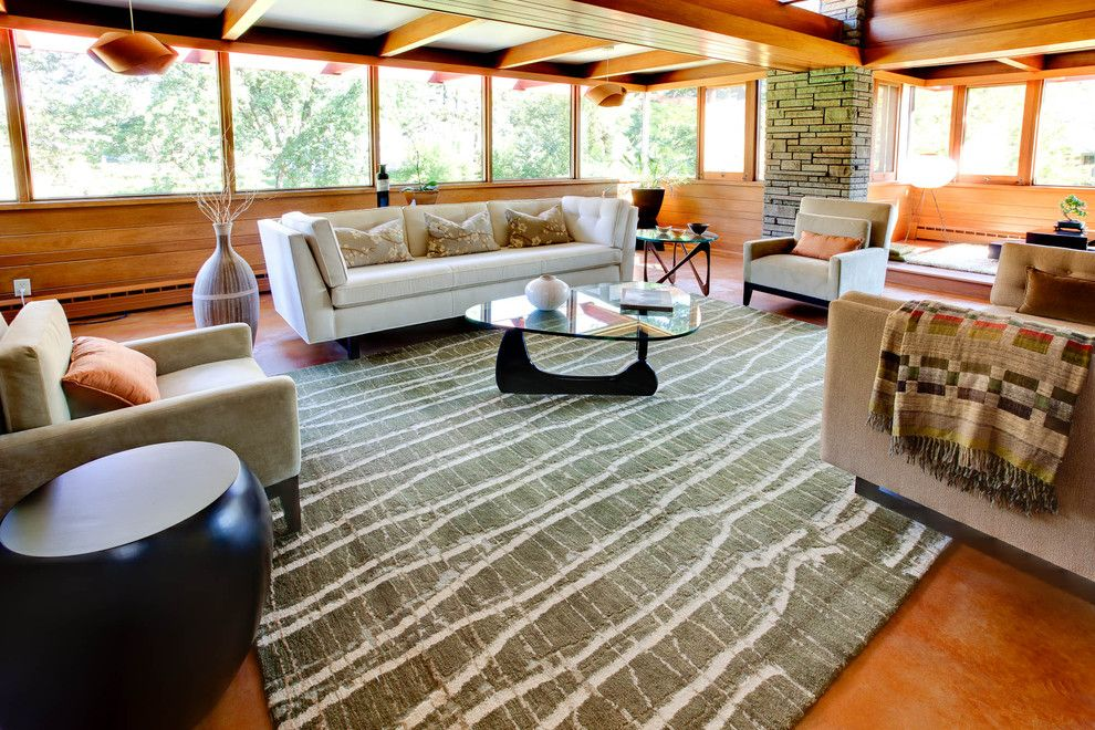Fallingwater House for a Midcentury Living Room with a Round Side Table and Christensen Remodeling by Genesis Architecture, LLC.