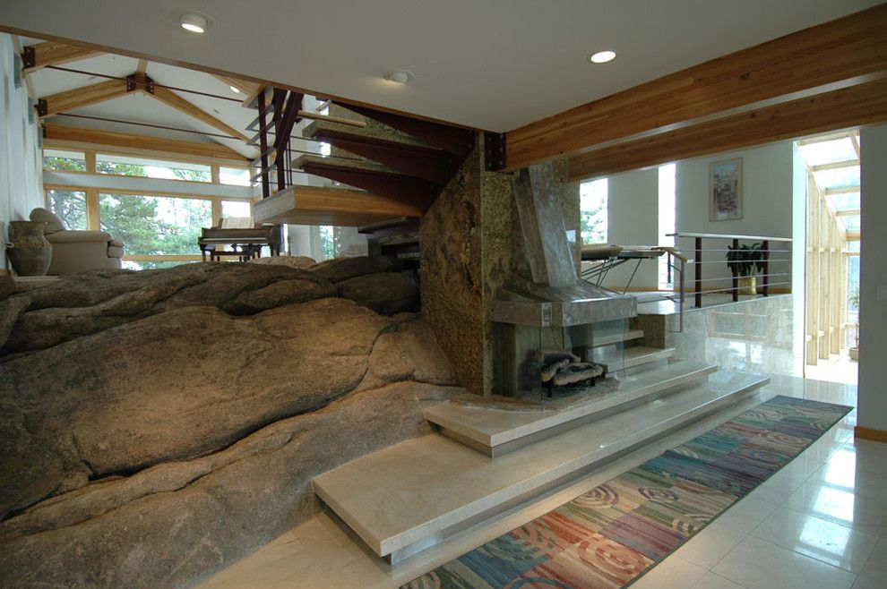 Fallingwater House for a Modern Living Room with a Fireplace and Project: The Golden Residence by Frederick Clifford Gibson by Frederick Gibson + Associates Architecture