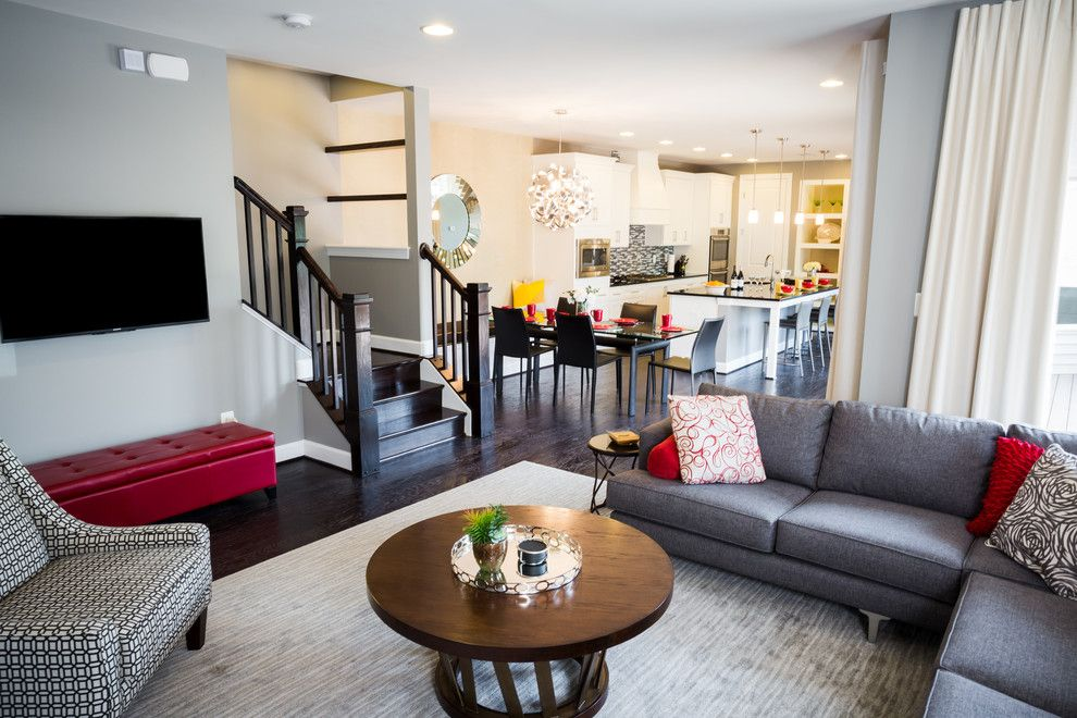 Fansedge Promo Code for a Contemporary Living Room with a Red Leather Ottoman and Sleek Contemporary Decor in Ashburn by Signature Design Interiors
