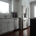 Fantasy Brown Granite for a Traditional Kitchen with a White Kitchen and Scholars by Wood Crafters Inc