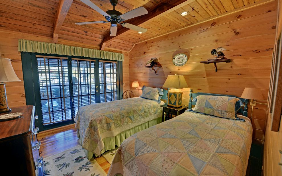 Farmington Valley Equipment for a Rustic Bedroom with a Wood Panel Walls and Lake Burton Custom Homes by Envision Web