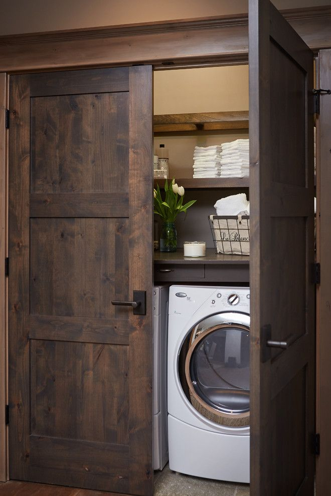 Feather River Doors for a Rustic Laundry Room with a Comfortable and Crooked River Home by Villa Decor