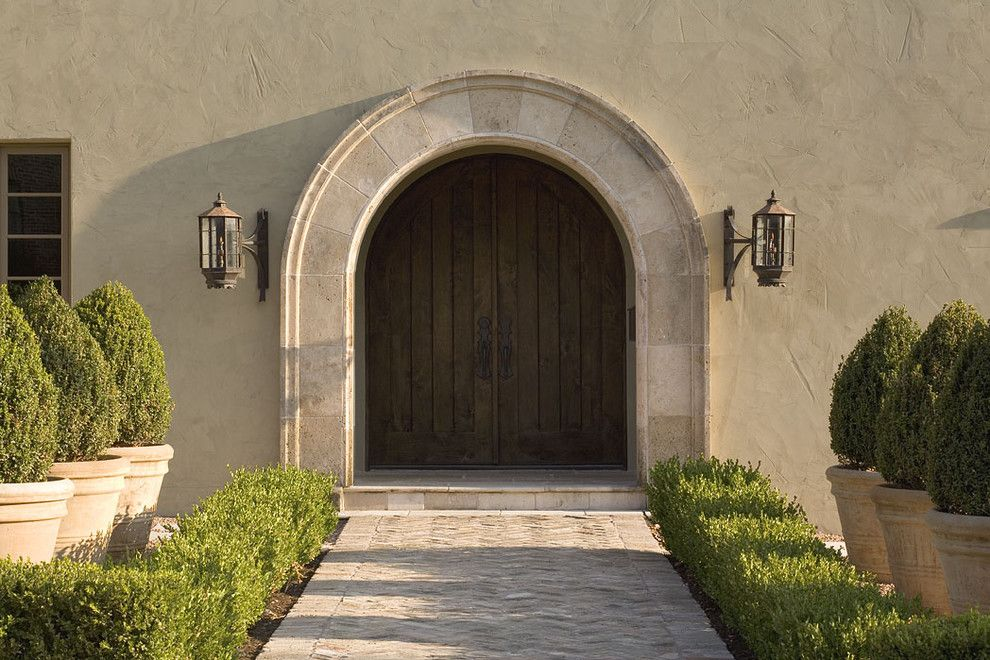 Feather River Doors for a Traditional Entry with a Path and Greenlee Entry by Hugh Jefferson Randolph Architects