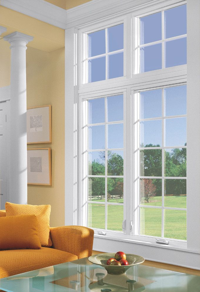 Feldco for a  Spaces with a Windows and Living Room: Casement Window by Feldco Windows, Siding and Doors
