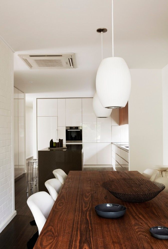 Feng Shui Bed Placement for a Midcentury Dining Room with a Pendant Lighting and Tracie Ellis' Home by Sharyn Cairns