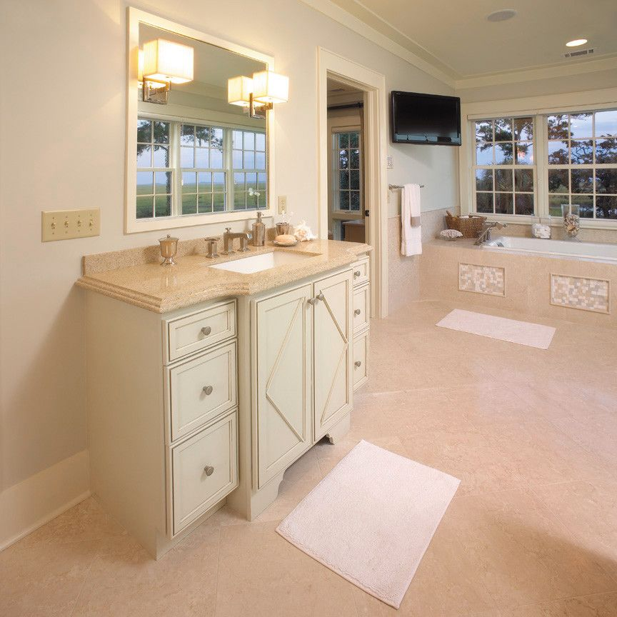 Fieldstone Cabinets for a Traditional Bathroom with a Vanity and Fieldstone Cabinetry in Coastal Living Magazine by Fieldstone Cabinetry