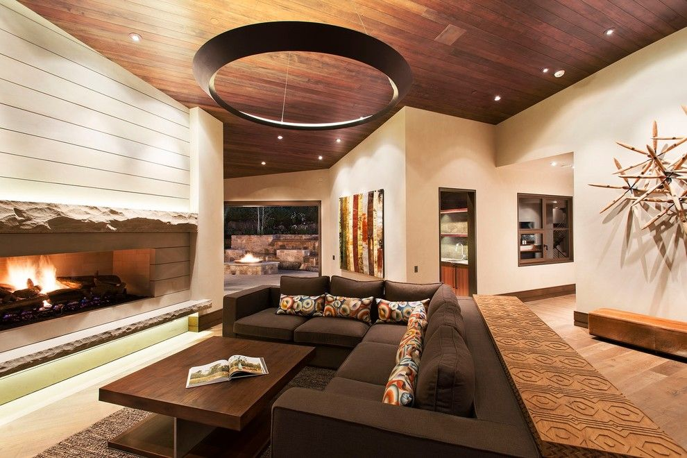 Fine Homebuilding for a Contemporary Living Room with a Wood Floor and Buttermilk by Kaegebein Fine Homebuilding