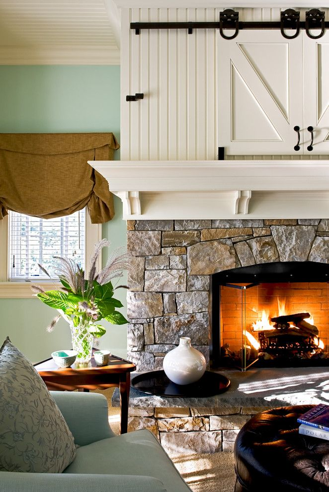 Fireplace Mantel Decor for a Traditional Bedroom with a Built in Storage and Crisp Architects by Crisp Architects