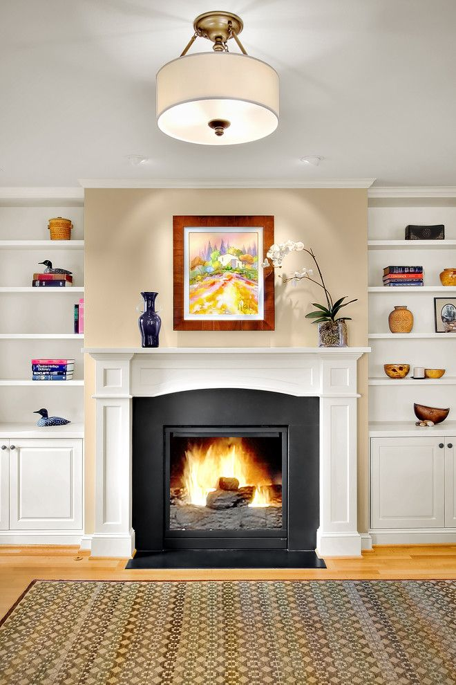 Fireplace Mantel Decor for a Traditional Family Room with a Bookcase and Queen Anne Residence 10 by Michael Knowles, Architect