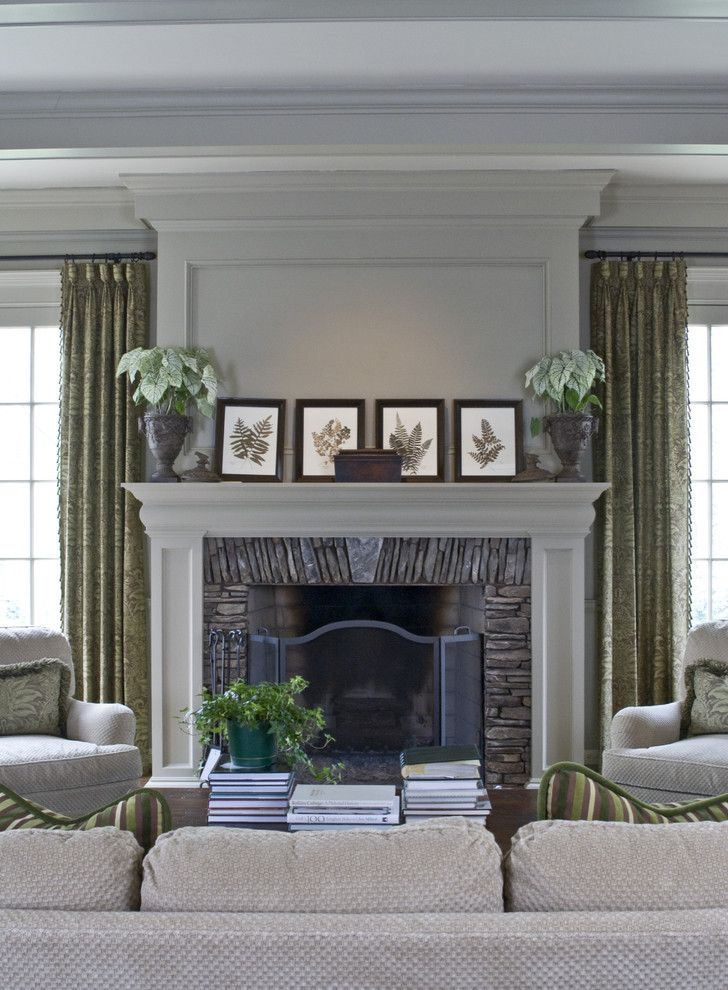 Fireplace Mantel Decorating Ideas for a Traditional Family Room with a S M and Traditional Family Room by Castrodesign.net