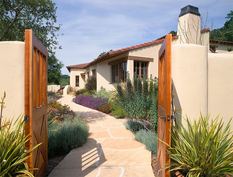 Flagstone Path for a Mediterranean Exterior with a Entry and Modern Homes by Duxbury Architects