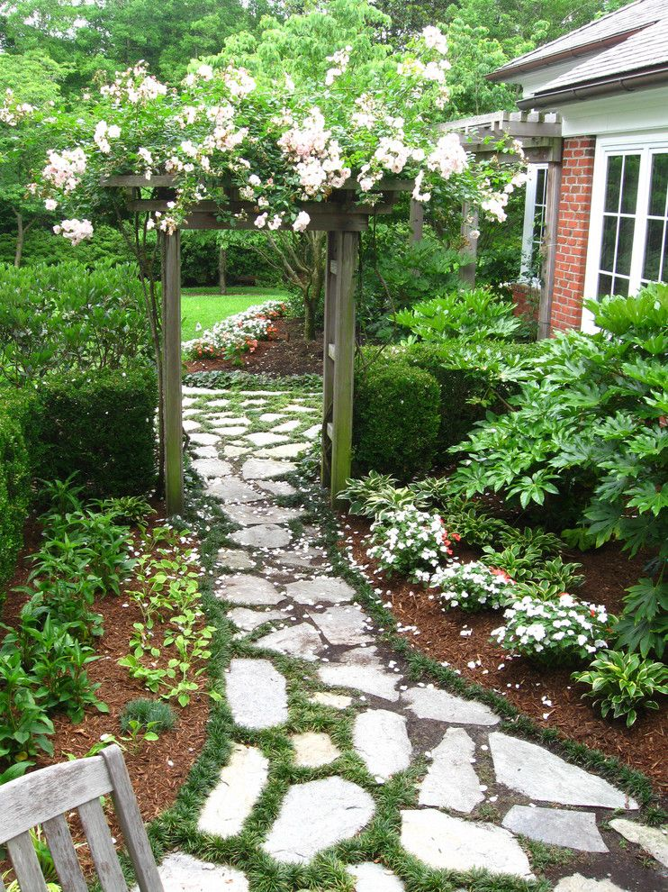 Flagstone Path for a Traditional Landscape with a Texture and Courtyard by Outdoor Creations Landscape & Design Inc.