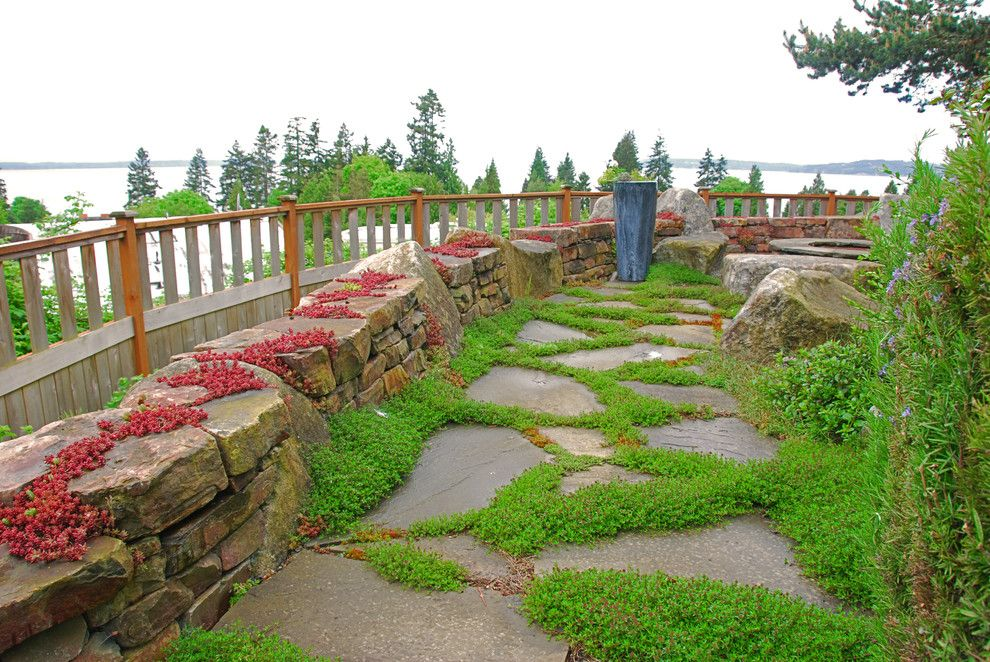 Flagstone Walkway for a Rustic Landscape with a Stone Wall and Dry Stacked Wall by Exteriorscapes Llc