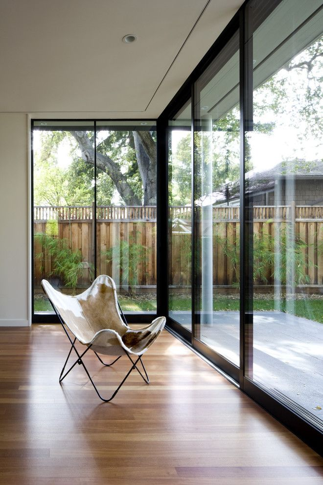 Fleetwood Doors for a Contemporary Living Room with a Butterfly Chair and Addition/Remodel of Historic House in Palo Alto by Cathy Schwabe Architecture