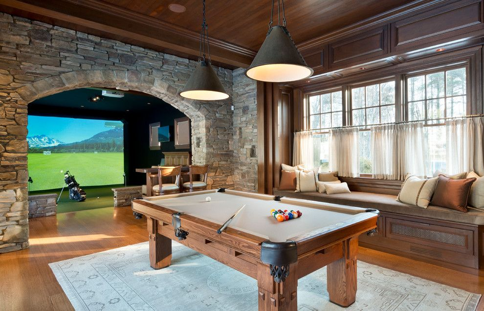 Floor Trader Okc for a Traditional Family Room with a Window Seat and Hd Golf Simulators by Bobbi Bulmer