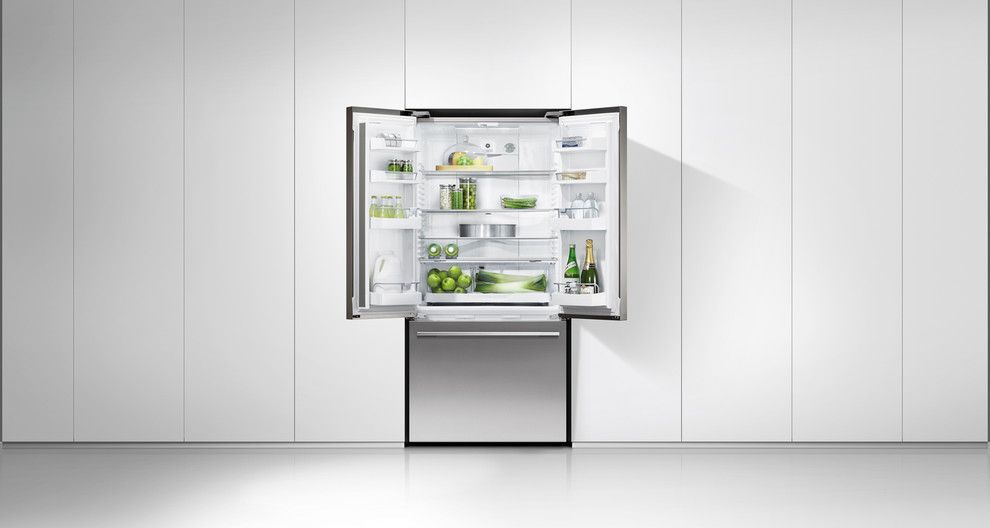 Florida Builder Appliances for a Modern Kitchen with a French Door Fridge and Fisher Paykel by Florida Builder Appliances