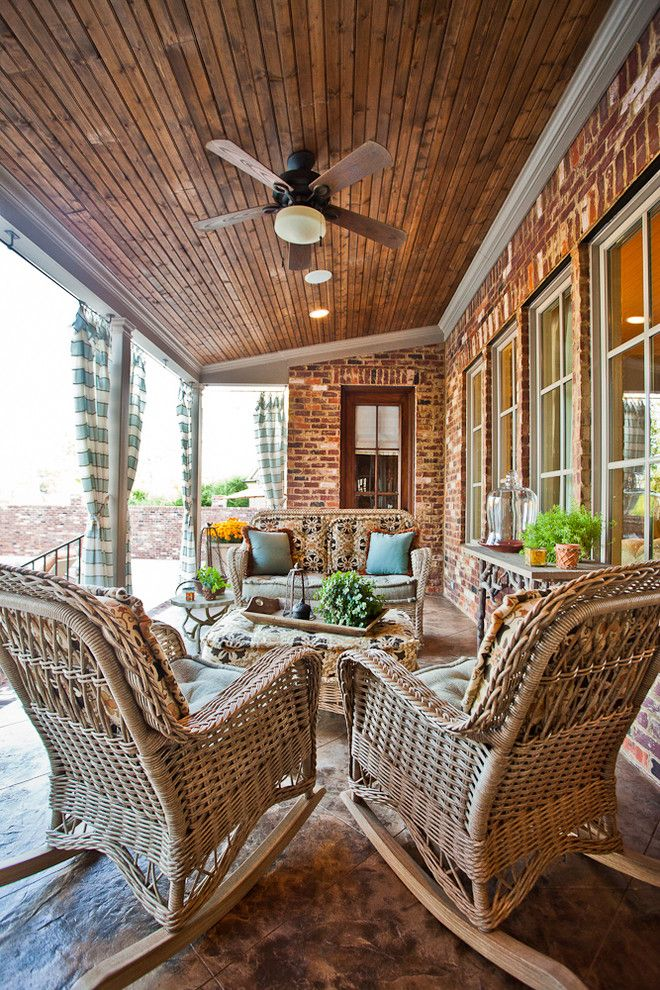 Forsyth Fabrics for a Traditional Porch with a Outdoor Furniture and Cooper Creek Back Porch by Eric Ross Interiors, Llc