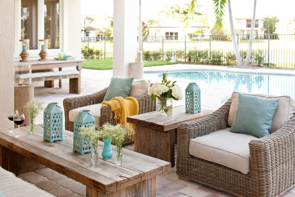 Forsyth Fabrics for a Transitional Patio with a Coffee Table and Evergrene Villa by Krista Watterworth Design Studio