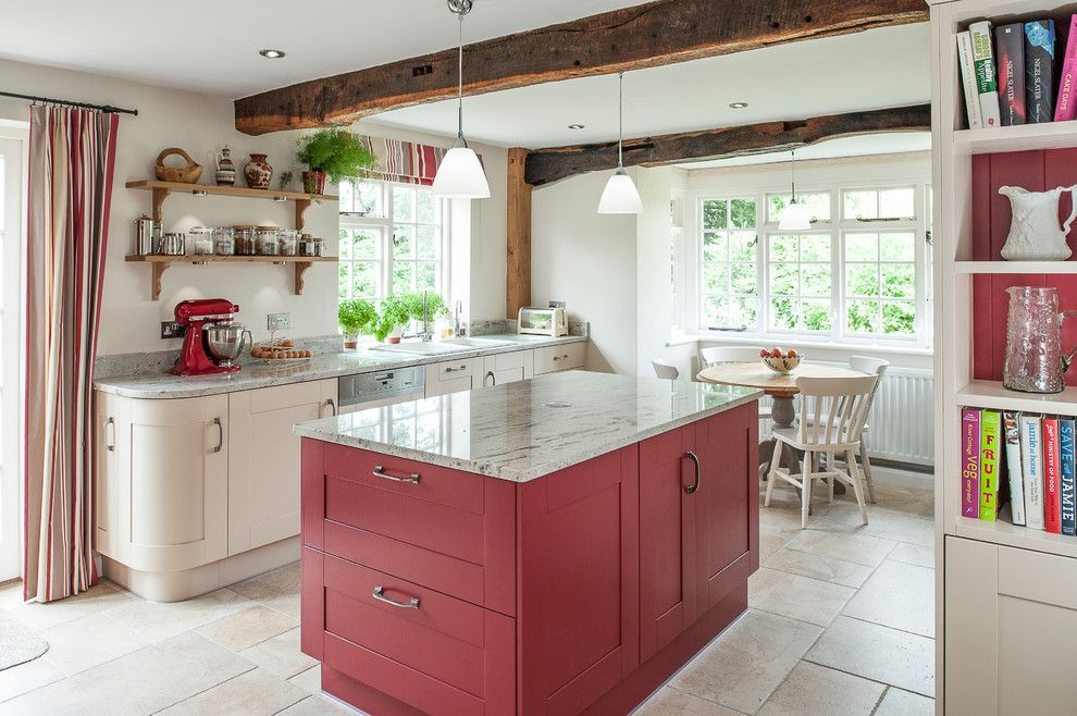 Freds Appliance for a Farmhouse Kitchen with a Round Dining Table and Cottage Kitchen Accented with Red by J M Interiors