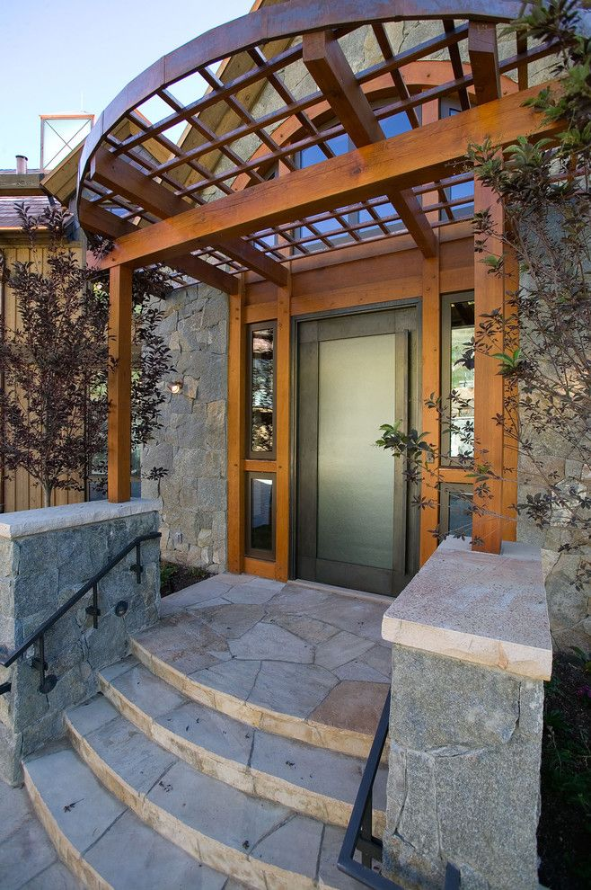 Front Porch Denver for a Contemporary Porch with a Metal Handrail and Front Entry by Dann Coffey Photography
