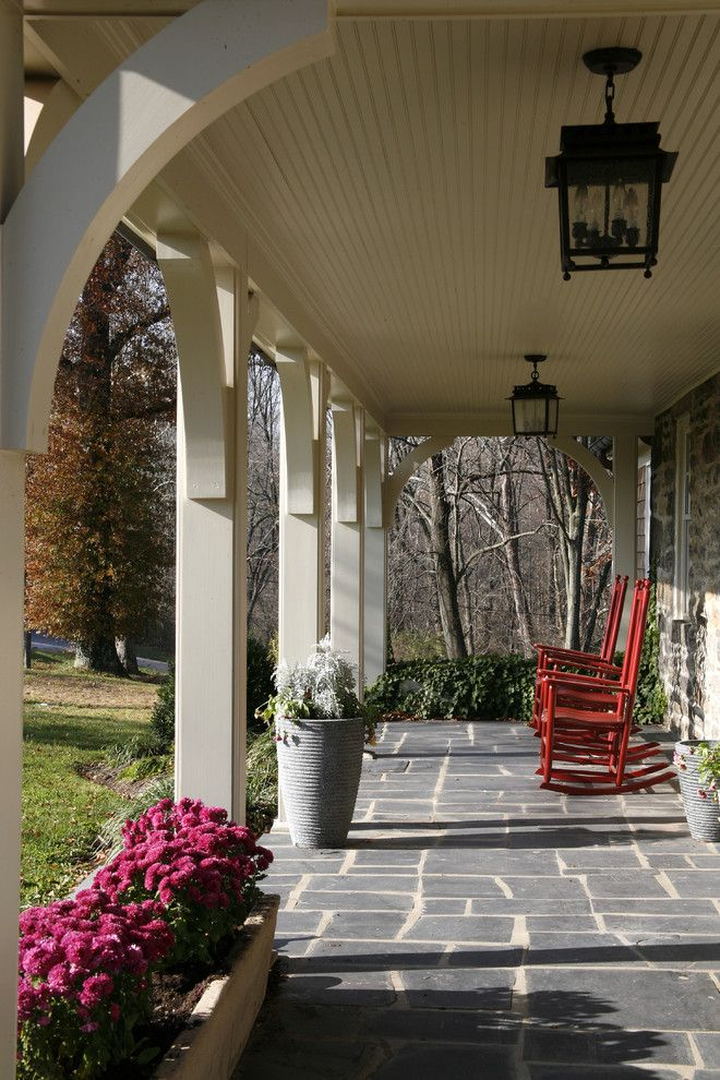 Front Porch Designs for a Traditional Porch with a Stone Paving and Front Porch by Melville Thomas Architects, Inc.