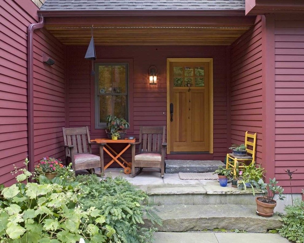 Front Stoop for a Rustic Porch with a Wind Chime and Housatonic Cape by Habitat Post & Beam, Inc.