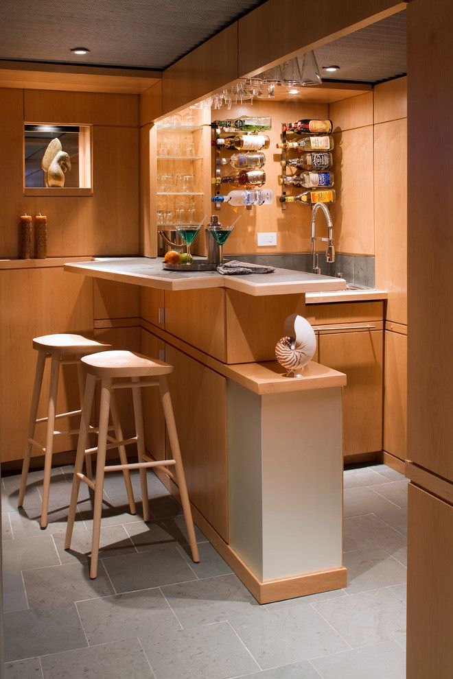 Fry Reglet for a Midcentury Basement with a Goose Neck Faucet and Lower Level Living by Princeton Design Collaborative