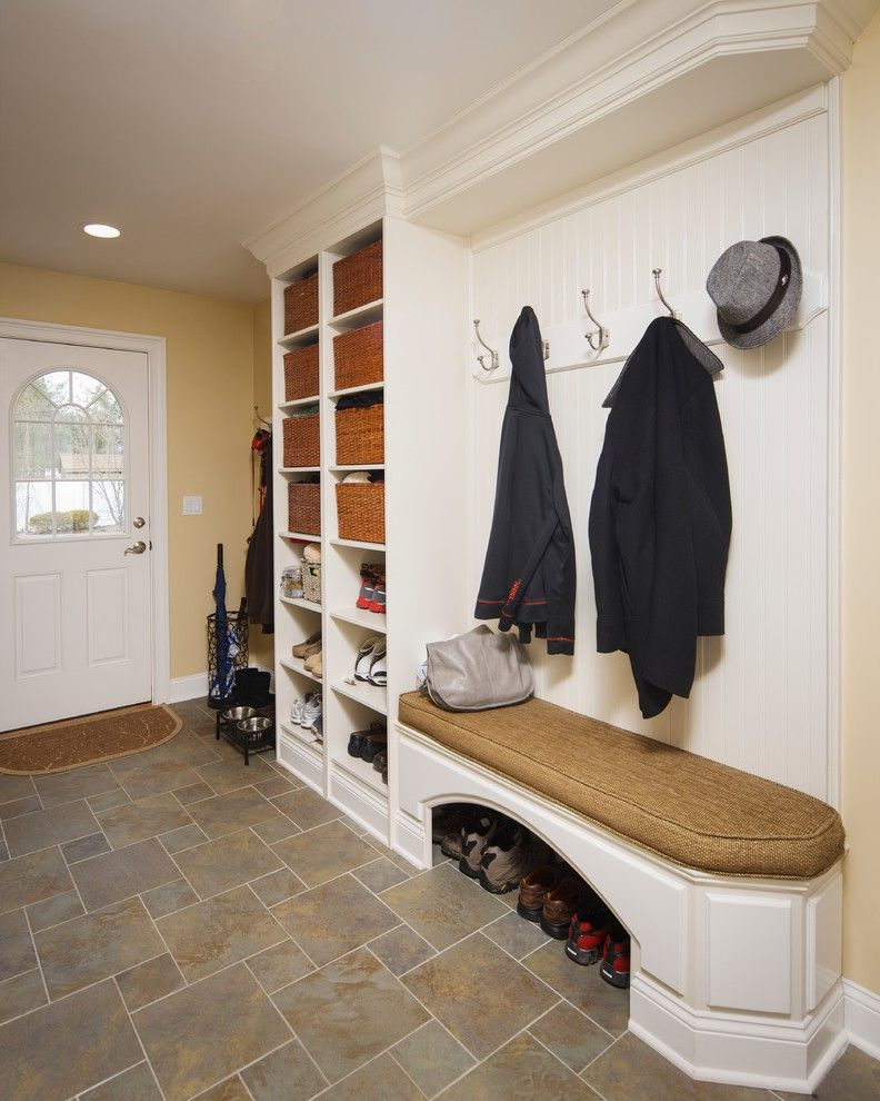 Fuda Tile for a Traditional Entry with a Mud Room and Warm and Welcoming by Creative Design Construction, Inc.